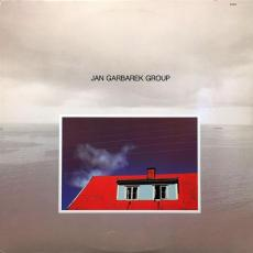 Garbarek, Jan Group - Photo With Blue Sky, White Cloud, Wires, Windows And A Red Roof